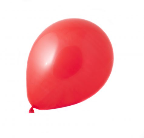 a singe red balloon isolated on a white background